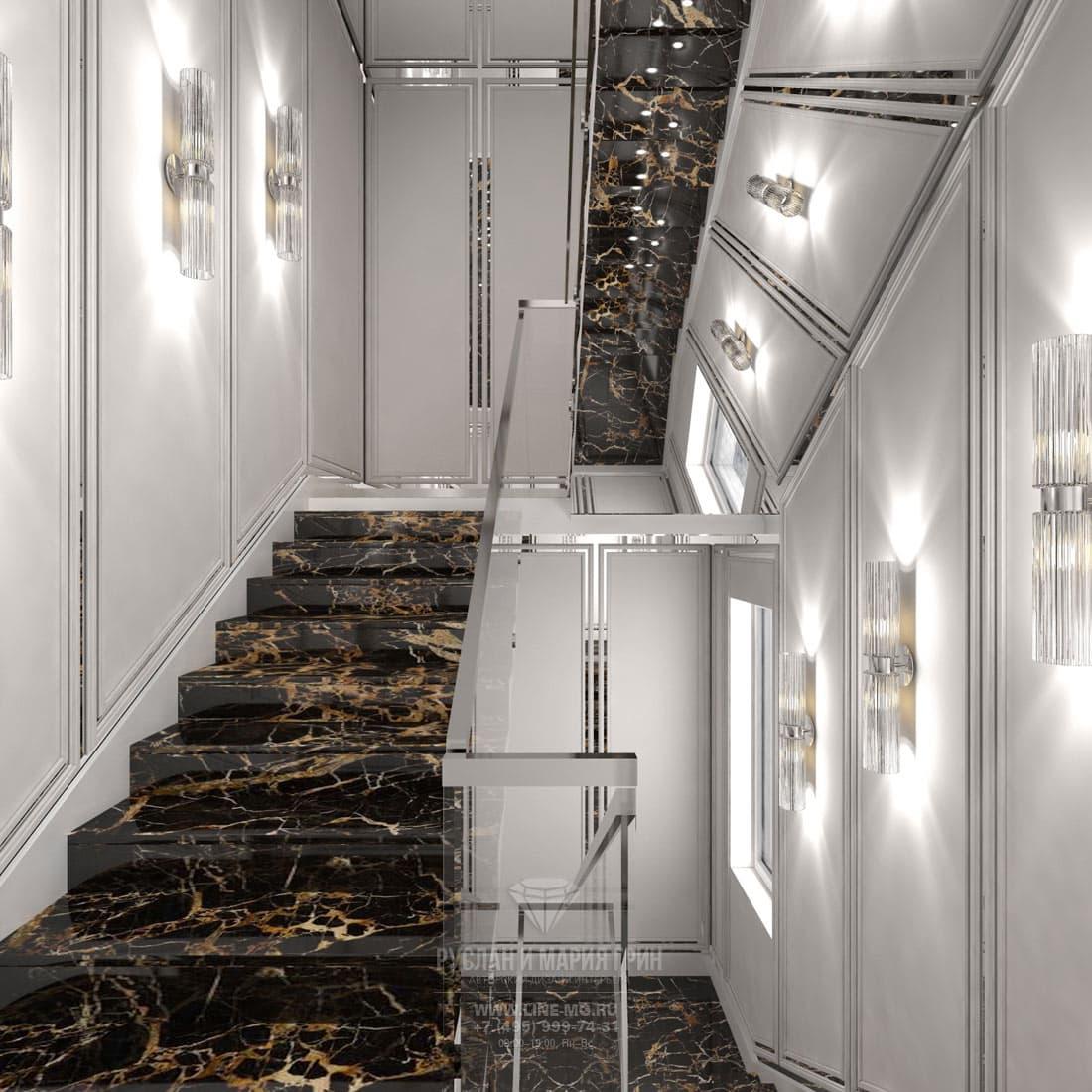 Интерьер лестничного холла с отделкой мрамором
