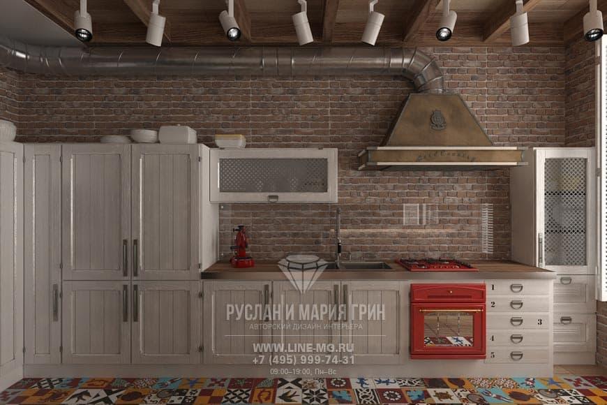 Интерьер лофтовой кухни с пестрой напольной плиткой