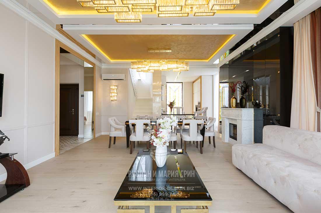 Дизайн гостиной-столовой коттеджа в стиле арт-деко. Фото после ремонта