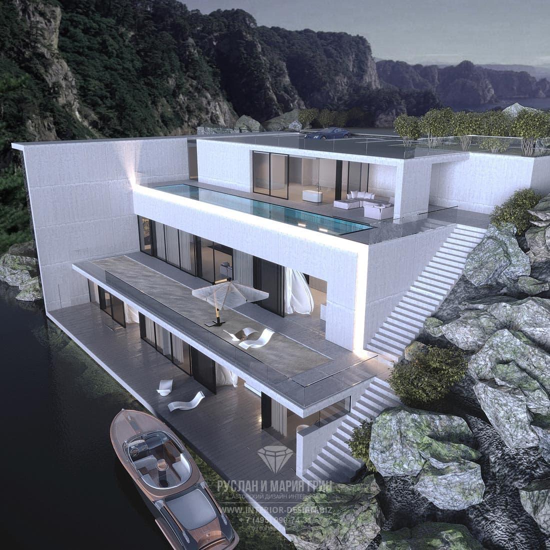 Фасад современного трехэтажного особняка