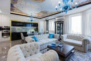 Дизайн интерьера роскошной гостиной в стиле совремнного арт-деко. Фото 2019
