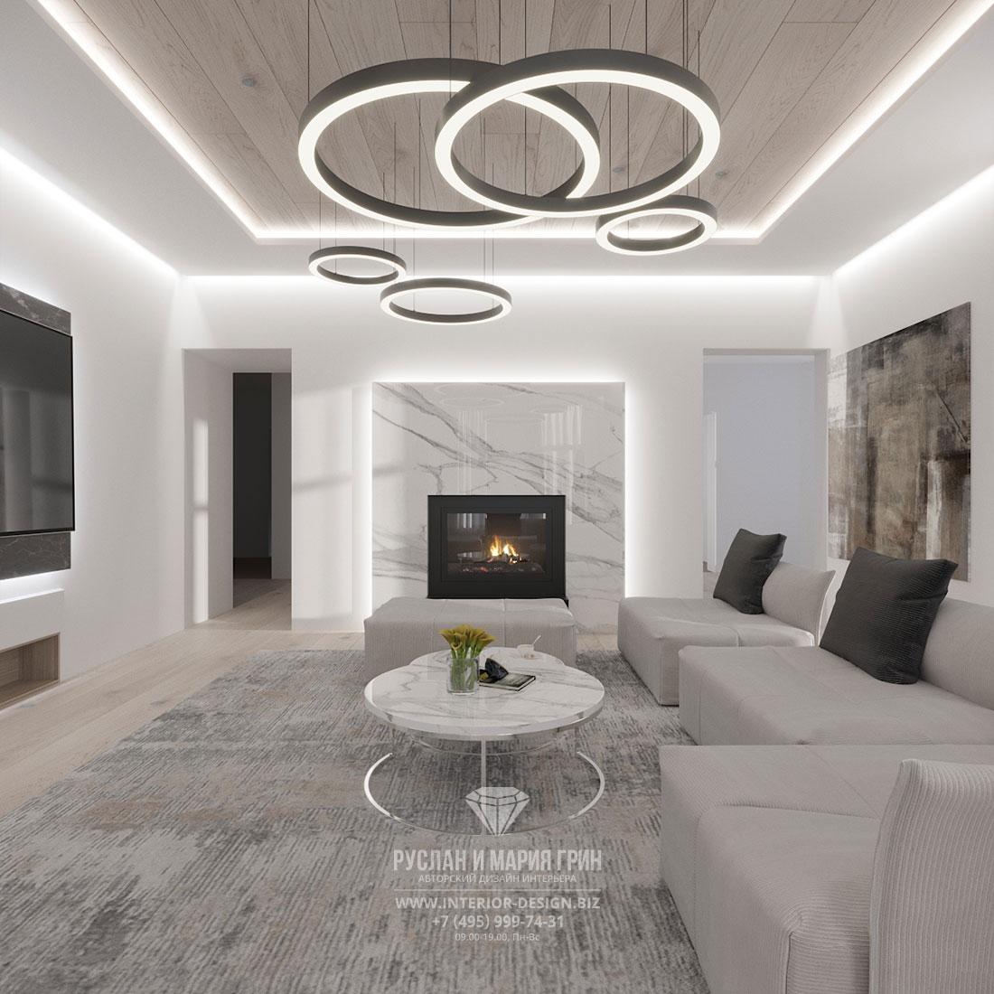Дизайн светлой гостиной в современном стиле с камином